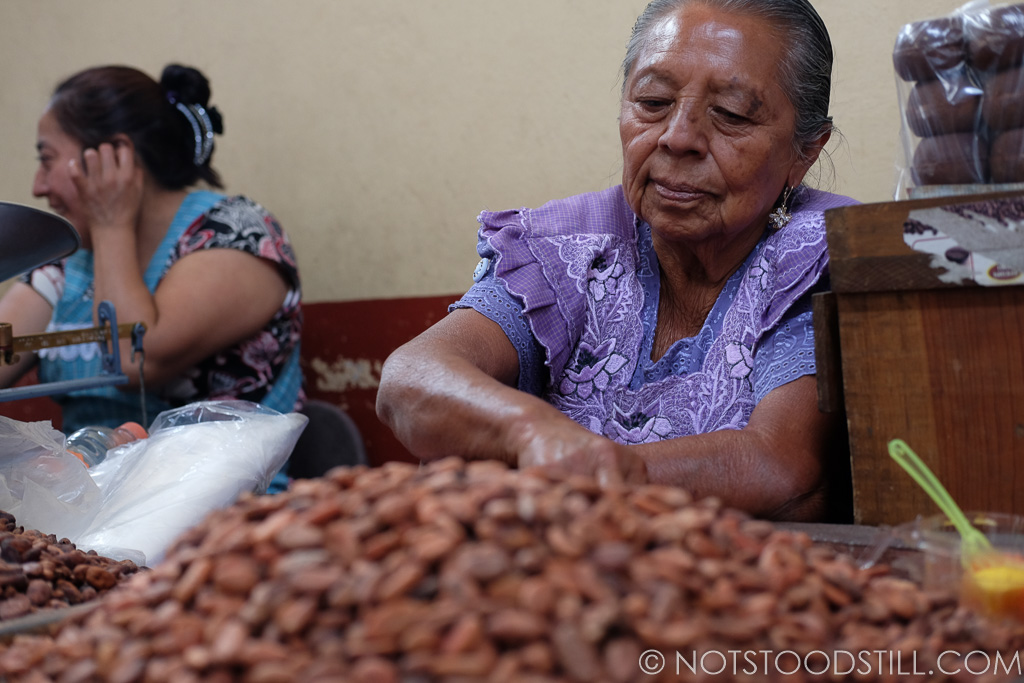 A woman selling Cocoa beans at Tlacolula Market