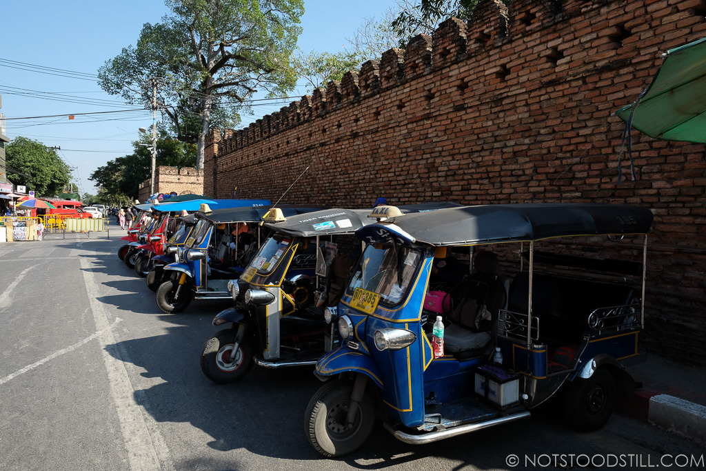 Tuk-tuks lined up by the old city walls.