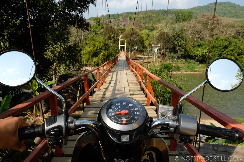 Crossing the suspension bridge, Kok River