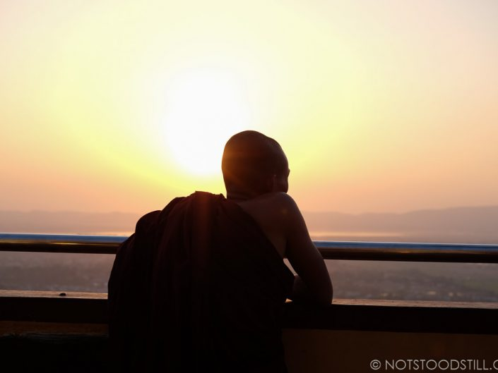 A monk watches the sunset at Sutaungpyei Pagoda, Mandalay Hill