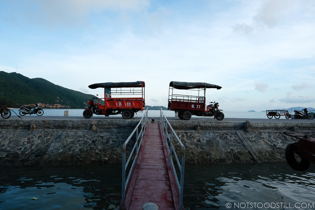 Tuk-tuks wait for us as we arrive on the Cai Rong Island