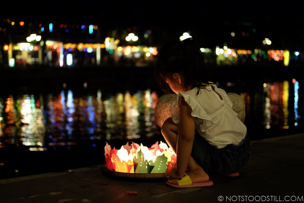 Floating lanterns on the river to bring luck
