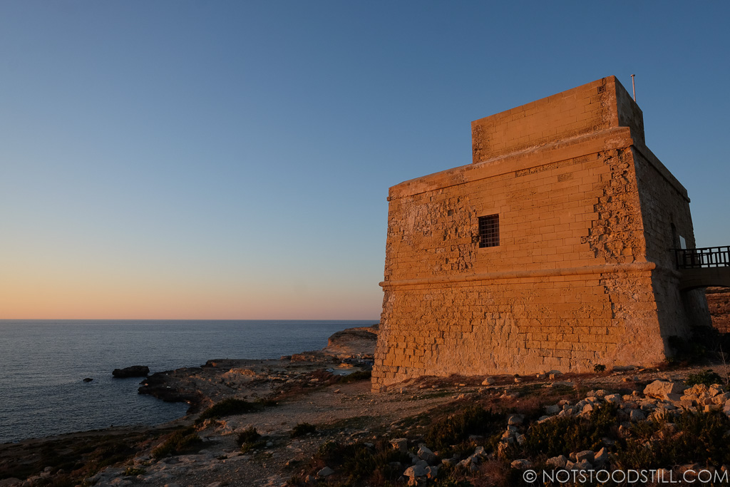 Watching the sunset from Dwejra Tower, near the site of the former Azure Window.