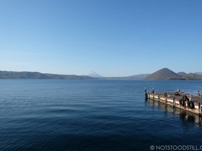 Tranquil Take Lake with a Mt Fuji lookalike in the distance.